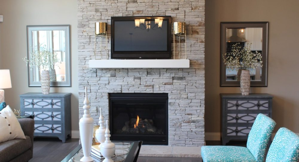 The floor to ceiling stone fireplace is a focal point of the great room and allows you to have a cozy fire at the flip of a switch.