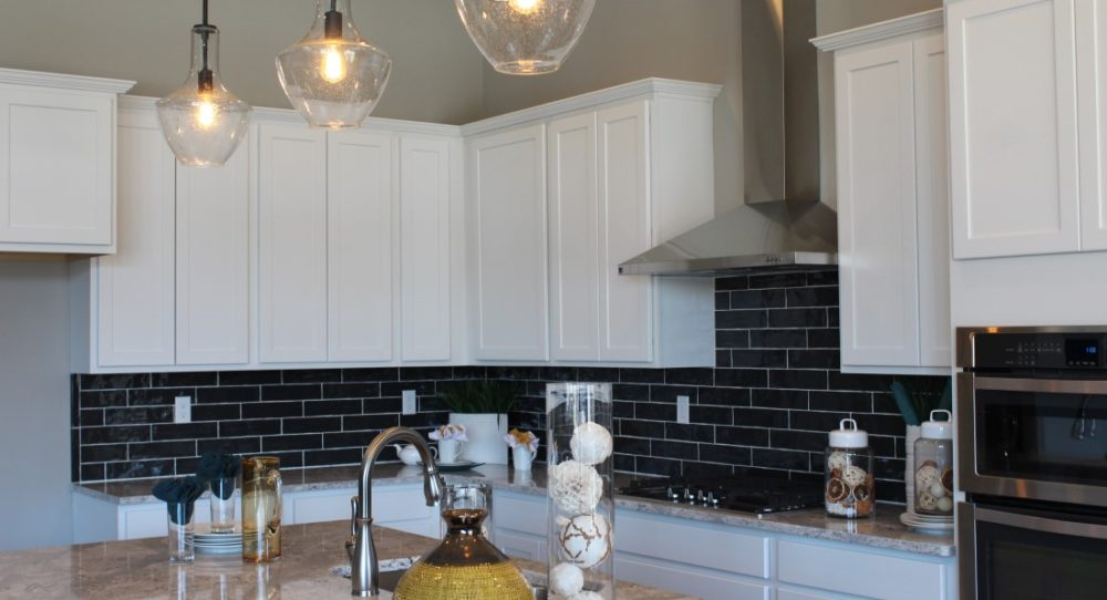 The Cook's Kitchen features a gas cooktop, oven/micro combo, dishwasher, and expansive prep island.