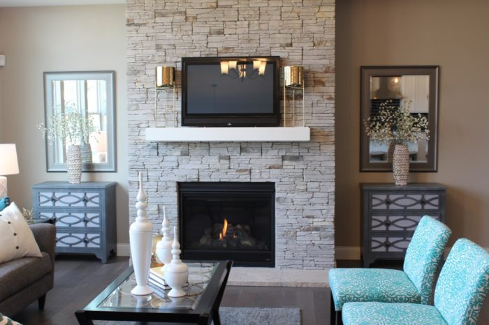 The floor-to-ceiling stone gas fireplace is a focal point or the Great Room.