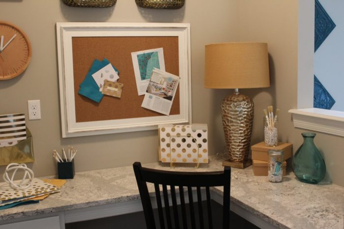 The planning nook has tons of storage, Cambria counters, and natural light via an opening into the Family Dining area.