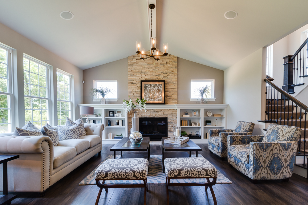 This great room has proper staging of the built in bookcases and proper furniture placemetn