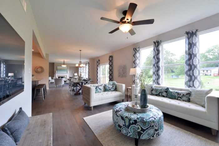 The Great Room, Family Dining and Hearth Room are all staged to appeal to buyers.